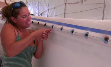 Amanda cutting the blue PVC out of the otherwise finished slots