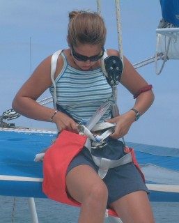 Amanda preps to go up the mast