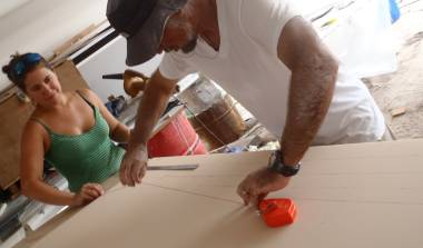 Amanda and Jon laying out cut-lines on the new foam