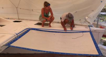 Amanda and Jon aligning the trampoline so they can mark the sides