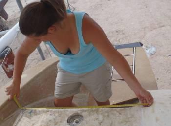 Amanda measuring for the swim platform steps
