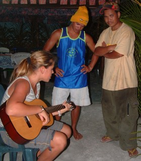 Amanda shows off her guitar style to the brothers