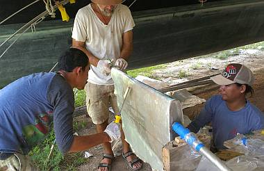 Baw, Jon and Heru wetting out another sheet of biaxial