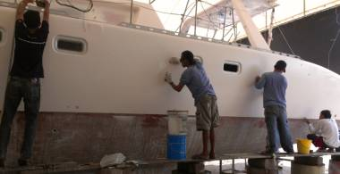 Baw, Lek, Pla & Nai sanding our newly re-sprayed port flank