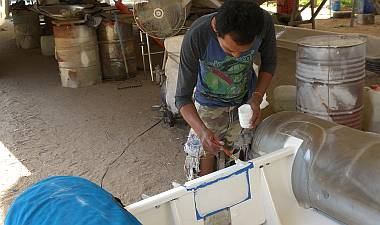 Baw painting the fiberglass plates we glued on yesterday