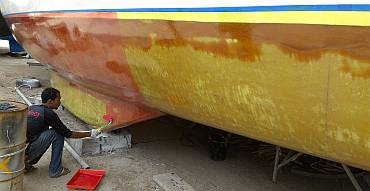 The first red layer going on top of the yellow layer