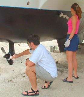 Touching up the bottom paint before launching