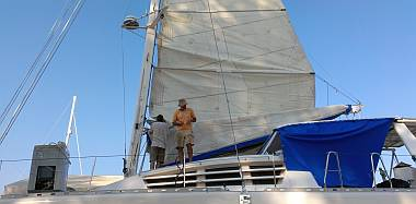 Bruce and Jon installing battens in the mainsail
