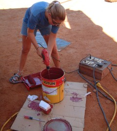 Amanda mixing up the paint to distribute the copper