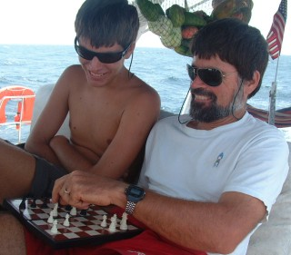 Playing chess on passage - note fruit net in background