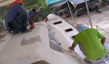 Sanding the filler smooth on Ocelot's starboard side