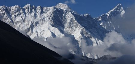 First view of Everest (center) behind Nuptse Ridge