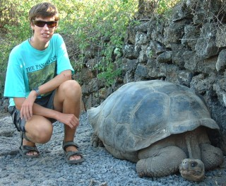 Chris and a Galapago at the Darwin Center