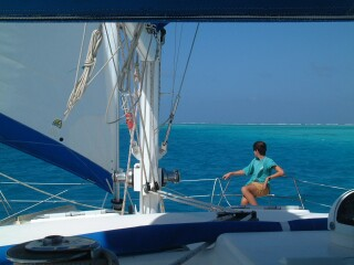 Chris on the bow as we dodge reefs in Los Roques