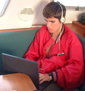 Chris typing an email as we sail