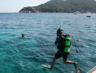 Chris entering the beautiful Similan Is. water