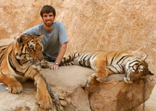 Chris with 2 Indo-Chinese Tigers. No, they're definitely not drugged.