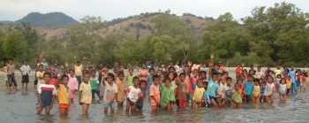 Kids from a village on Flores gather on the beach to see us off
