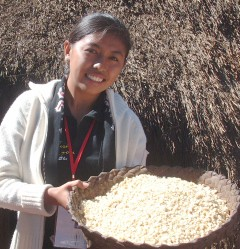 Nita holds up drying corn at her family home