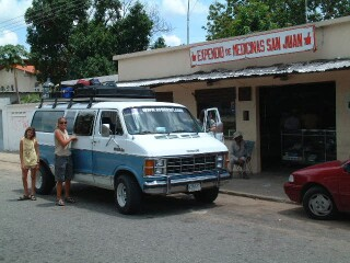 Amanda and Kat next to our van at a snack stop in Los Llanos