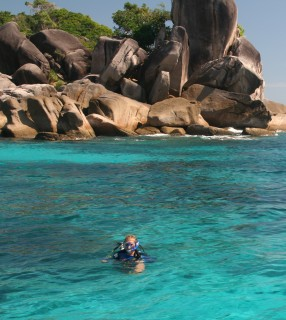 Rachel preparing to descend for a dive in the clear waters of the Similans