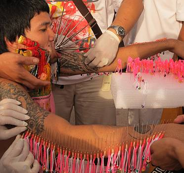 Extreme cases add decorated needles along their arms