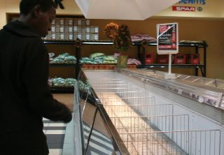 Empty shelves at a big grocery chain in Harare