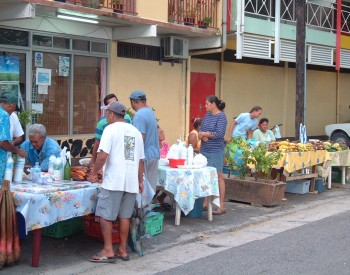 The morning market in Fare is a small affair along the side of the street.