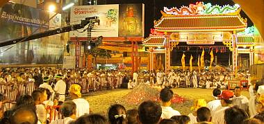 Crowds at the temple around the huge pile of glowing coals