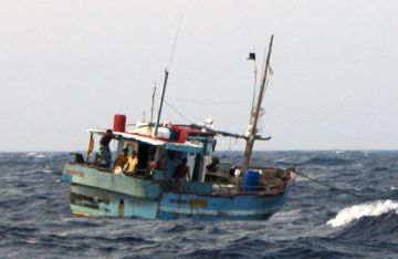 Fishing boat anchored at sea, 300 miles from India