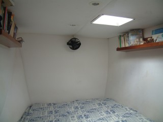 The strb foreword cabin with its fan and bookshelves.