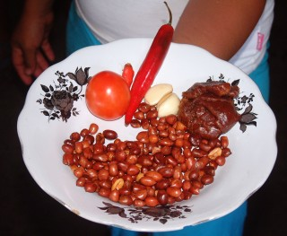 Karol displaying the peanut sauce ingredients