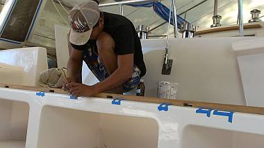Heru repairing the gelcoat where yesterday's screws went in