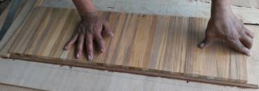 Houa's teak strips, lined up to be cut into lattice pieces