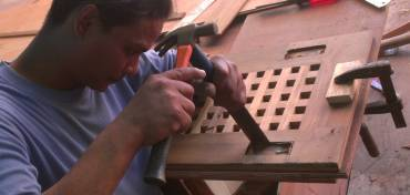 Houa cutting out damaged screw-holes from his teak lattice
