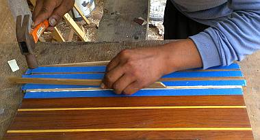Houa gluing in a strip of ash to replace a strip of holly