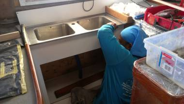 Houa fitting the sink on top of his new facade in the galley