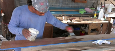 Houa applying epoxy sealer to his teak board for the salon