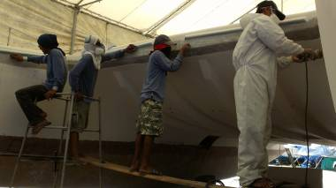 Jack, Lek, Nut and Pla sanding the front of the inner hulls