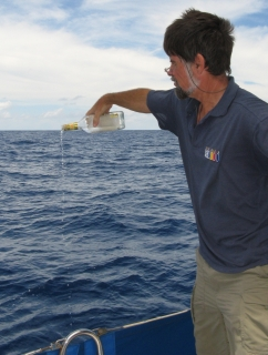Jon offers Neptune a libation of gin on the Equator