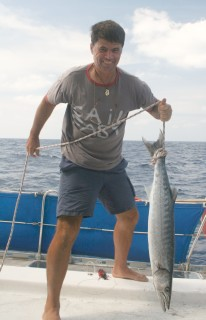 Jon lands a big barracuda in the Indian Ocean