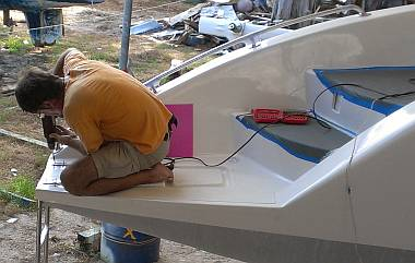 Jon mounting the portside swim ladder to the transom