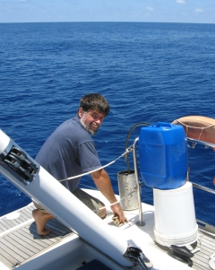 Jon refuels with diesel while at sea.