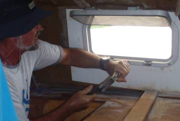 Jon removing screws from our forward hatches