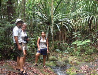 Jon, Sue and Amanda pause by a stream in the rainforest near Suva.