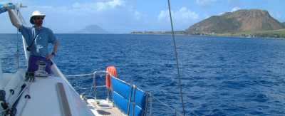 Sailing past the fort on Brimstone Hill, St. Kitts, with St. Eustatia in the background
