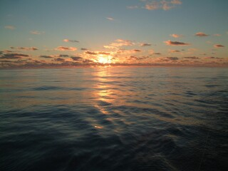 The sun greets another day on the vast Pacific Ocean