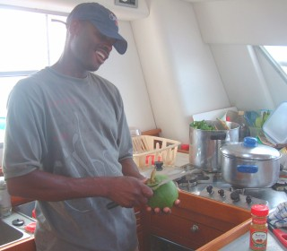Alexis of Dominica chopping vegies for the land crab stew on Ocelot