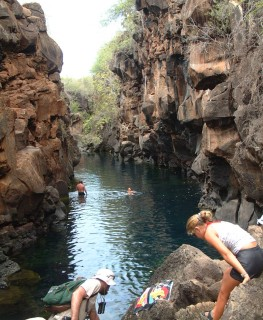 Tony and Amanda prepare to climb down into the clear waters of Las Grietas