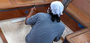 Lek brushing another coat of epoxy onto some of the salon teak